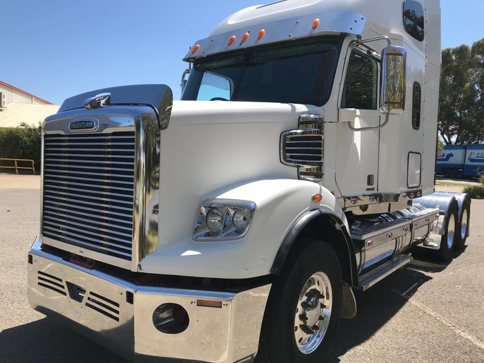 2012 Freightliner Coronado 122 58 XT Sleeper White cab, Red chassis