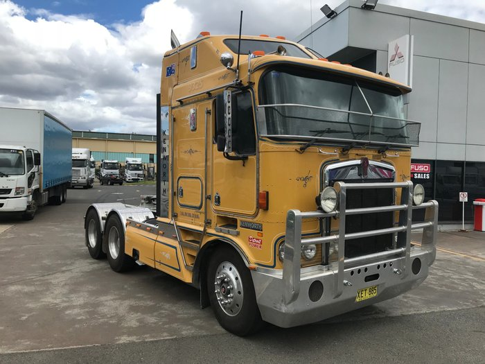 2002 Kenworth K104 K104 AERODYNE BROWN