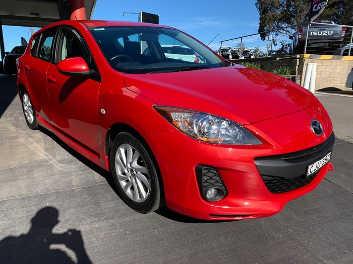 2012 MAZDA Mazda3 MAZDA3 H 6 SPEED MANUAL HATCH DIESEL Velocity Red