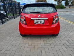 2015 Holden BARINA MY16 Holden BARINA X AUTO 5D HATCHBACK 4CYL Red